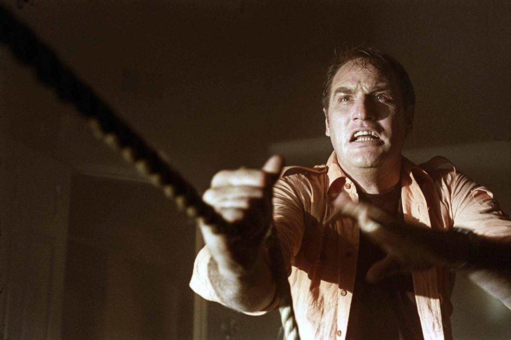 Craig T. Nelson as Steven Freeling trying to beckon both his daughter and wife back to world of the living in Poltergeist.
