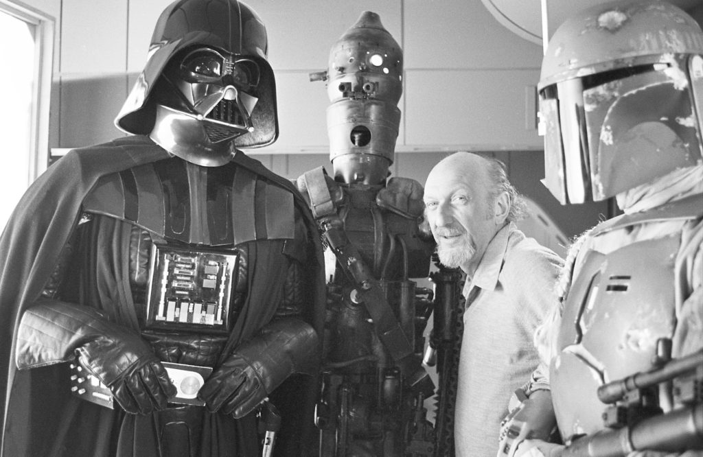 A behind the scenes photo of Irvin Kershner on the set of The Empire Strikes Back.