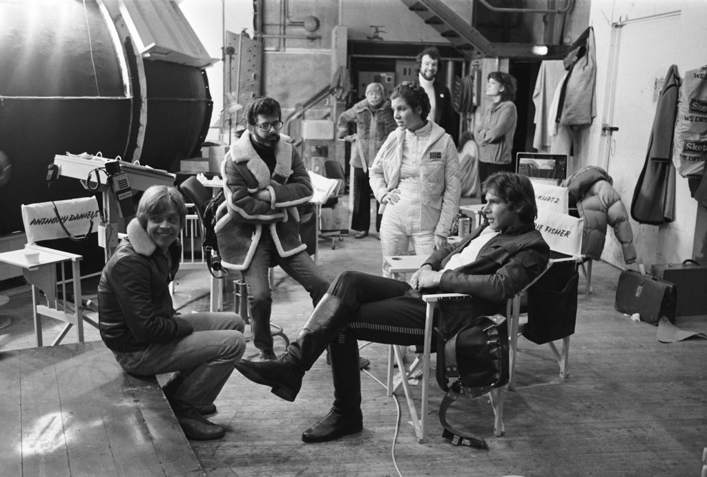 Mark Hamill, George Lucas, Carrie Fisher, and Harrison Ford on the set of The Empire Strikes Back.