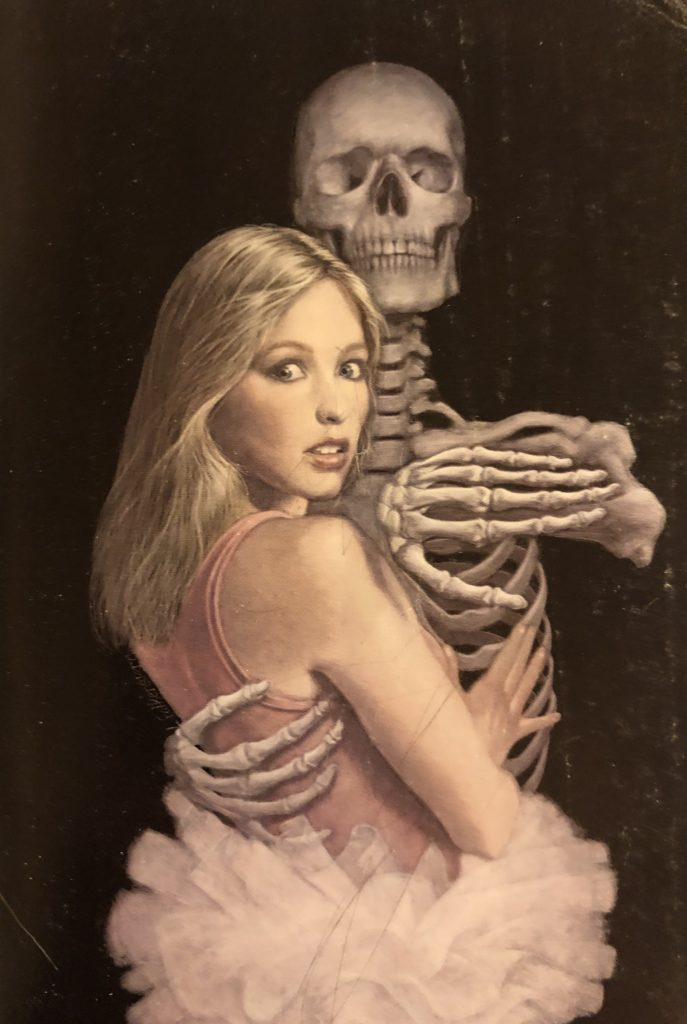 Beautiful interior book art of a skeleton dancing with a ballerina
