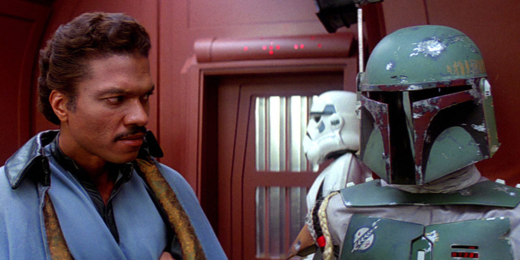 Lando Calrissian (Billy Dee Williams) speaks with Boba Fett in a tense moment from The Empire Strikes Back.