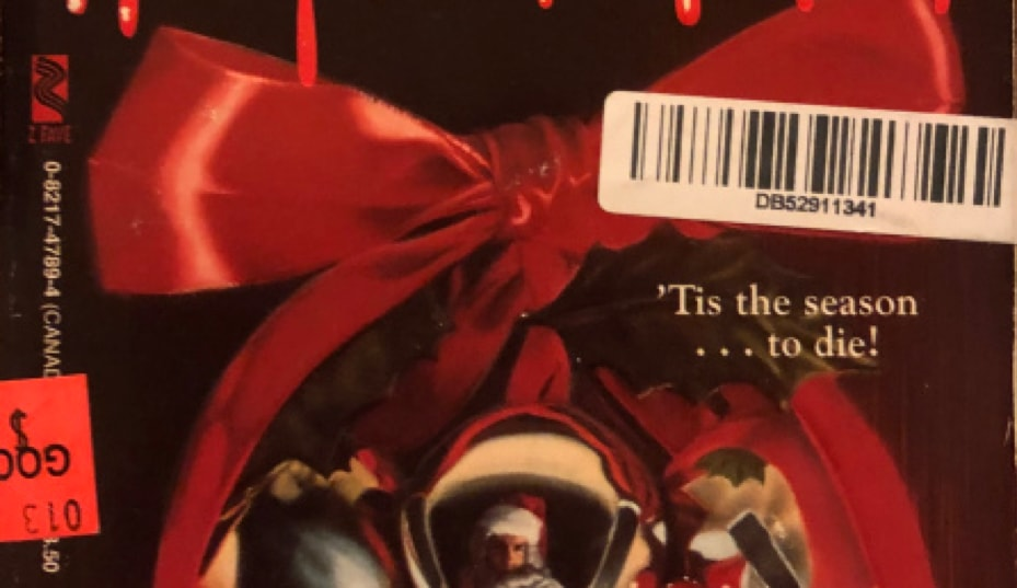 Close up . shot of the barcode sticker on the front cover of Slay Bells