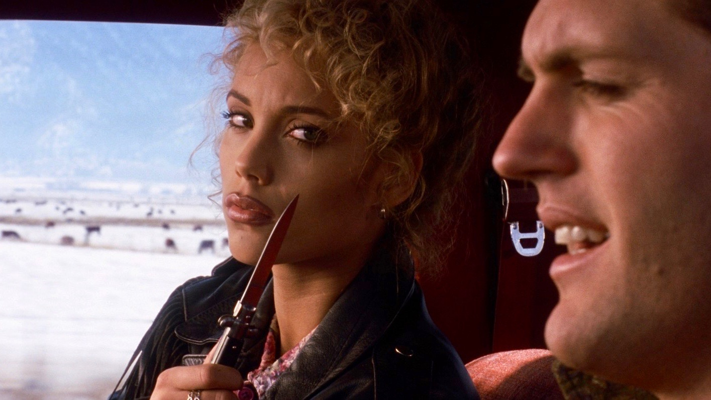 "Nomi Malone shows off her switchblade in the opening scene of ""Showgirls"""