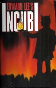 """First edition cover for """"Incubi"""" with a silhouetted man holding fire in his hand."""