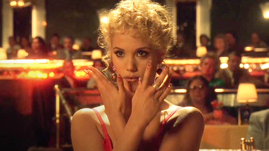 Nomi Malone makes jazz hands in 1995's Showgirls